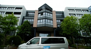 A car with the logo of German software group SAP stands near its headquarters in Walldorf