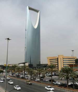 Cars drive past the Kingdom Centre Tower in Riyadh, Saudi Arabia