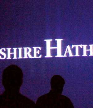Berkshire Hathaway shareholders walking by a video screen at the company's annual meeting in Omaha