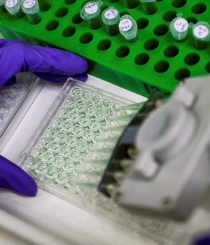 Scientist prepares protein samples for analysis in a lab at the Institute of Cancer Research in Sutton, Britain.