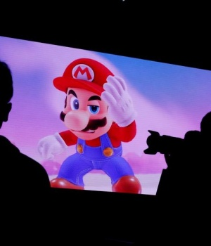 Nintendo's game character Super Mario is seen on a screen at the presentation ceremony of Nintendo's new game console Switch in Tokyo