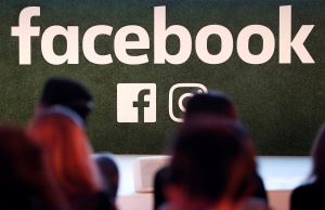 Facebook logo is seen at Facebook Gather conference in Brussels