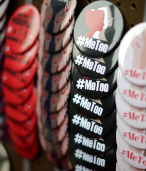 A vendor sells #MeToo badges at a protest march for survivors of sexual assault and their supporters in Hollywood