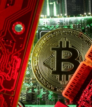 A copy of bitcoin standing on PC motherboard is seen in this illustration picture