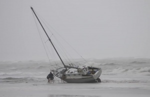 A boat is stranded on the shore in Nelson, after the downgraded Tropical Cyclone Fehi brought heavy rain in New Zealand