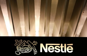he Nestle logo is pictured on the company headquarters entrance building in Vevey