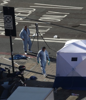 Forensic investigators work at the scene of an attack where a van was driven at muslim worshippers outside a mosque in Finsbury Park in North London