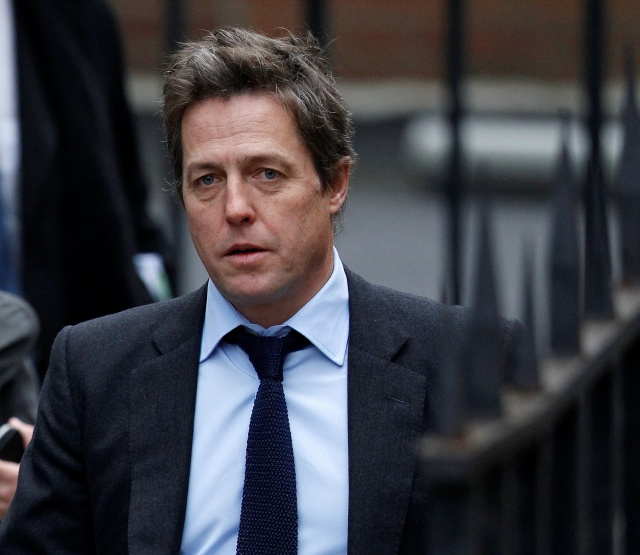 British actor Hugh Grant arrives at the Leveson Inquiry at the High Court in central London
