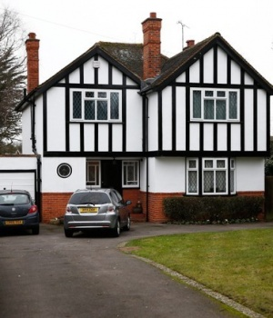 Cars are parked outside an address which has been linked by local media to former British intelligence officer Christopher Steele, in Wokingham
