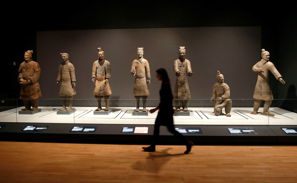 A member of the museum staff walks past a display of Terracotta Warriors which guarded the tomb of China's First Emperor, Qin Shi Huang, on loan from China in The World Museum, Liverpool
