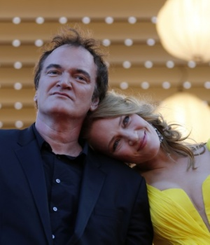 "Director Quentin Tarantino and actress Uma Thurman pose on the red carpet they arrive for the screening of the film ""Sils Maria"" in competition at the 67th Cannes Film Festival in Cannes"