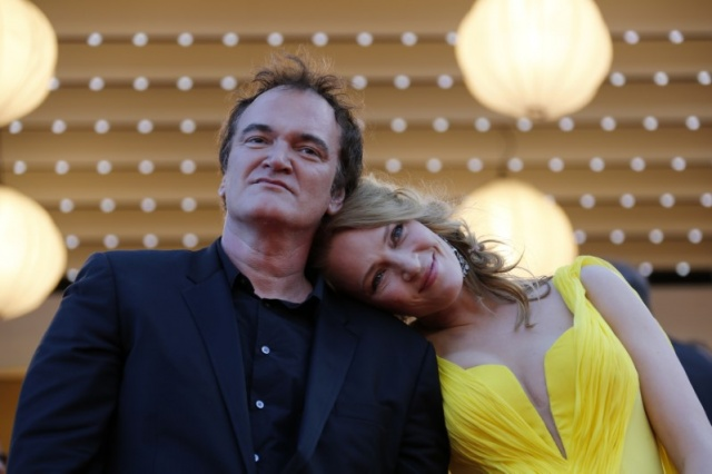 Director Quentin Tarantino and actress Uma Thurman pose on the red carpet they arrive for the screening of the film
