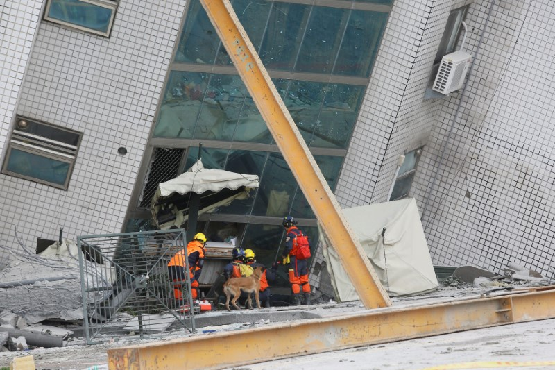 Rescue workers are seen outside a damaged building after an earthquake hit Hualien