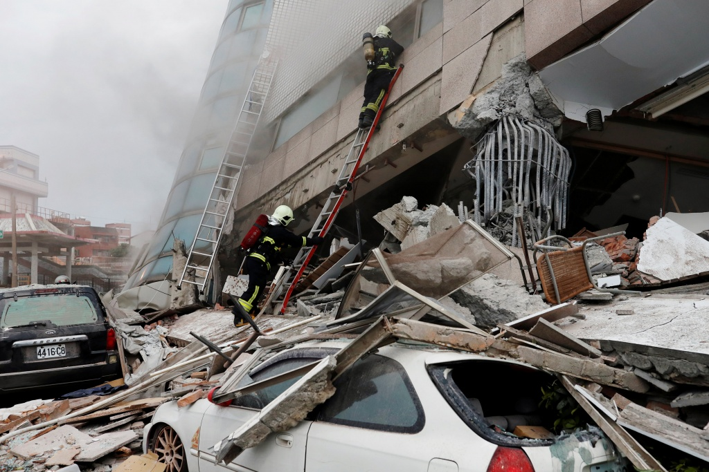 Fire fighters look for survivors after an earthquake hit Hualien