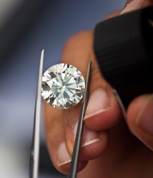 A trader inspects a diamond during a four-day show at Israel's Diamond Exchange near Tel Aviv