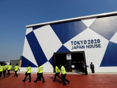 Security personnel pass by the Tokyo 2020 Japan House during a media preview in Gangneung