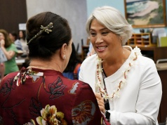 Hawaii Lieutenant Governor candidate Iwamoto speaks with a constituent in Honolulu