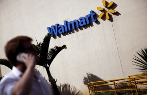 A man talks on his mobile phone in front of a Wal-Mart store in Sao Paulo