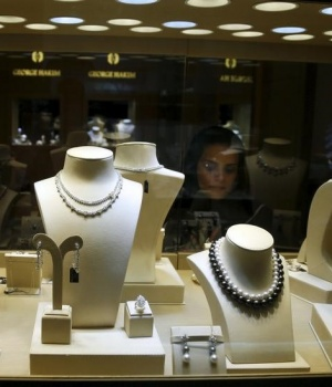 Woman looks at jewellry during a Jewellery exhibition in Riyadh