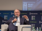 Former U.S. president George W. Bush speaks on stage at a business conference in Abu Dhabi