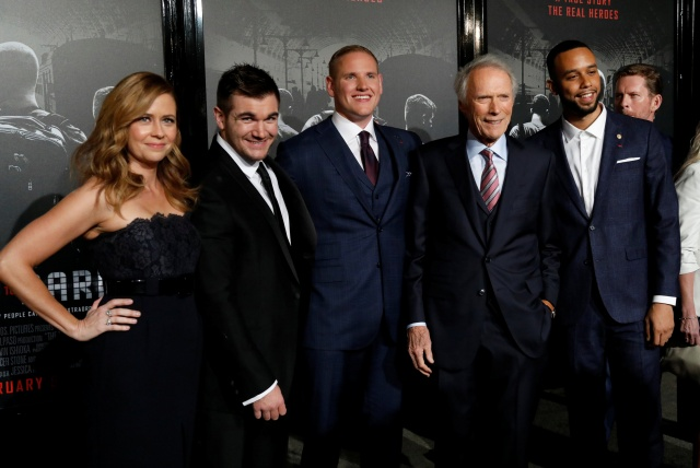 Director Eastwood poses with cast members Fischer, Skarlatos, Stone and Sadler at a premiere for