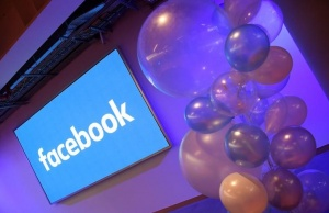 Balloons are seen in front of a logo at Facebook's headquarters in London