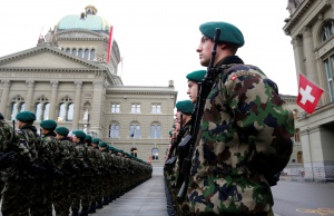Swiss Army soldiers stand a guard of honour before the ceremonial for South Korean President Park on the Federal Square in Bern