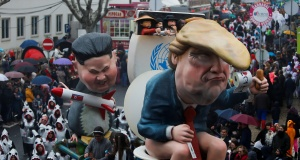 A carnival chariot is seen with figures of U.S. President Donald Trump and North Korean leader Kim Jong Un during a parade in Torres Vedras