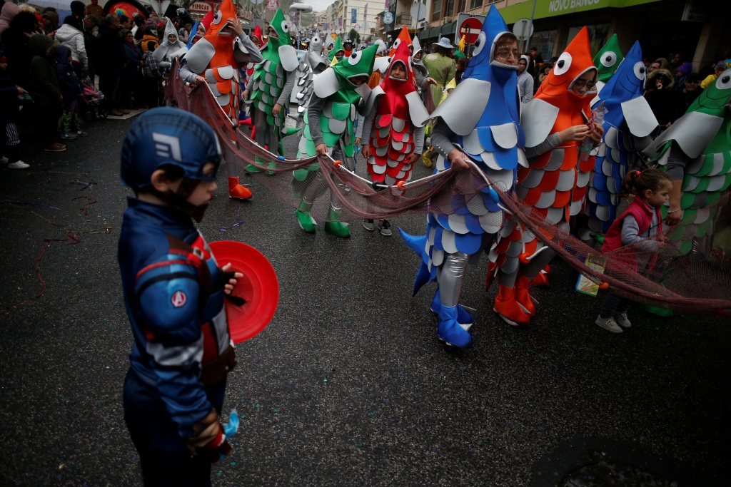 Carnival participants march during a parade in Torres Vedras