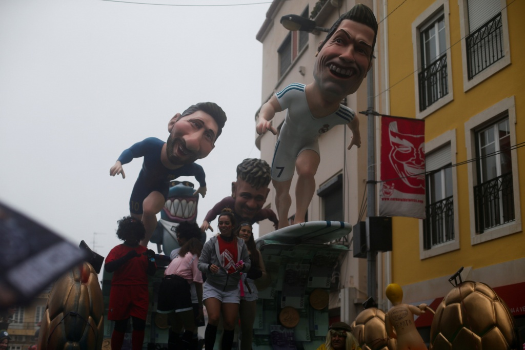 A carnival chariot is seen with figures of soccer players Cristiano Ronaldo, Leonel Messi and Neymar during a parade in Torres Vedras