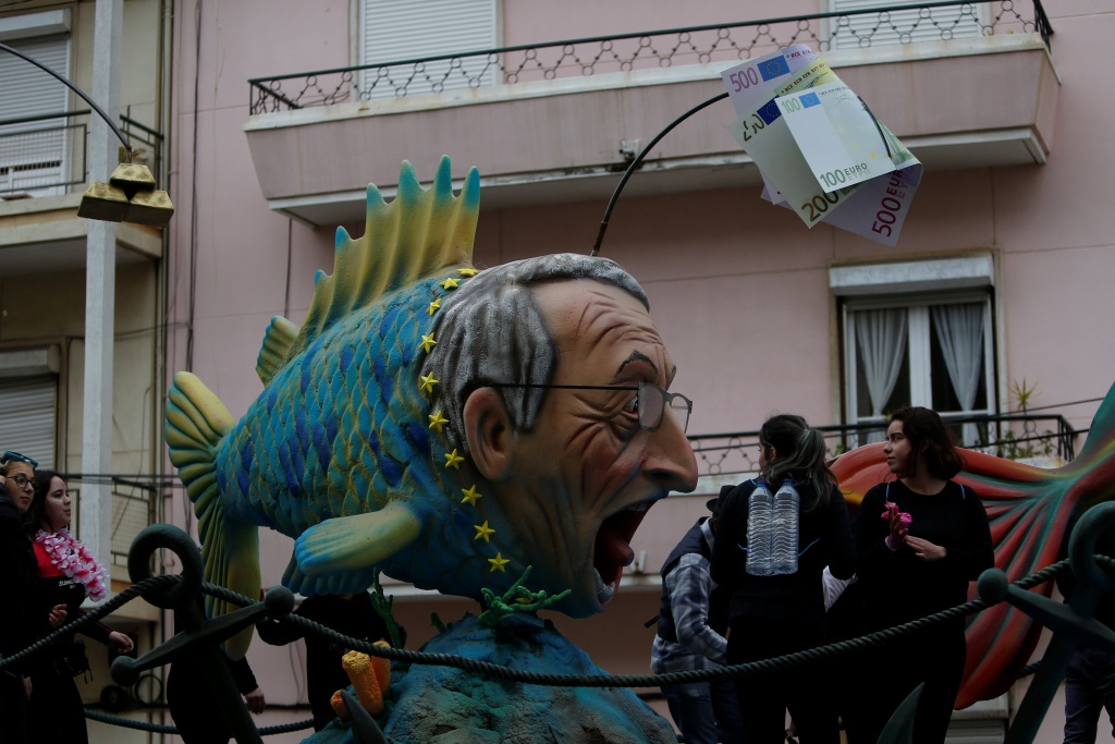 A carnival chariot is seen with a figure of European Commission President Jean-Claude Juncker during a parade in Torres Vedras