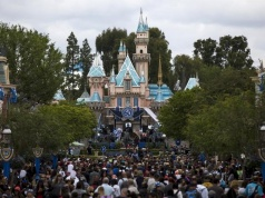 People are seen on the Main Street during Disneyland's Diamond Celebration in Anaheim