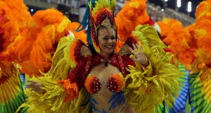 A reveller from Sao Clemente Samba school performs during the first night of the carnival parade at the Sambadrome in Rio de Janeiro