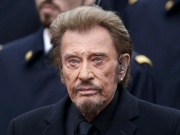 French singer Johnny Hallyday attends a ceremony at Place de la Republique square to pay tribute to the victims of last year's shooting at the French satirical newspaper Charlie Hebdo, in Paris