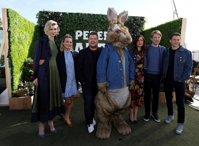Director of the movie Gluck poses with cast members Debicki, Robbie, Corden, Byrne, Gleeson and the character of Peter Rabbit during a photo call for