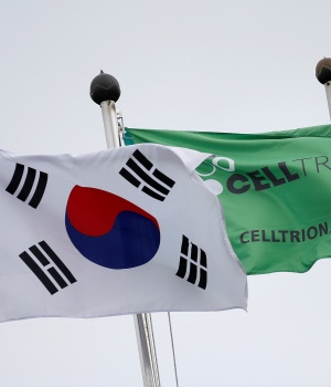 Flags bearing the South Korean national flag and Celltrion's flag flutter in the wind at the company's headquarters in Incheon