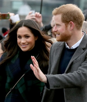 Meghan Markle and Britain's Prince Harry, meet members of the public during a walkabout on the esplanade at Edinburgh Castle