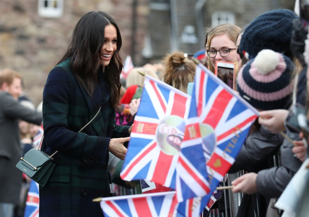 Meghan Markle, the fiancee of Britain's Prince Harry, meets members of the public during a walkabout on the esplanade at Edinburgh Castle