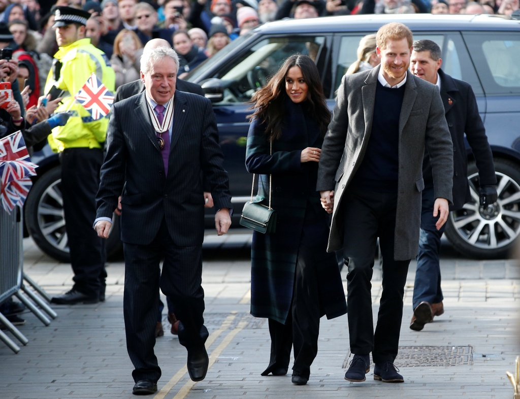 Britain's Prince Harry and his fiancee Meghan Markle arrive for a visit to the Social Bite, a social business and cafe, in Edinburgh