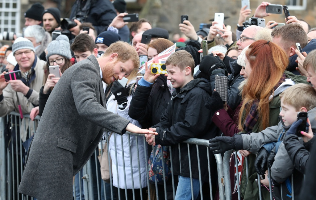 Britain's Prince Harry meets members of the public during a walkabout on the esplanade at Edinburgh Castle