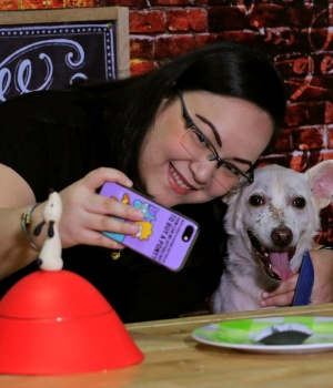 "A pet lover takes a selfie with a shelter dog during a ""Date with Dogs"", inside the Philippine Animal Welfare Society (PAWS) headquarters in Quezon city, metro Manila"