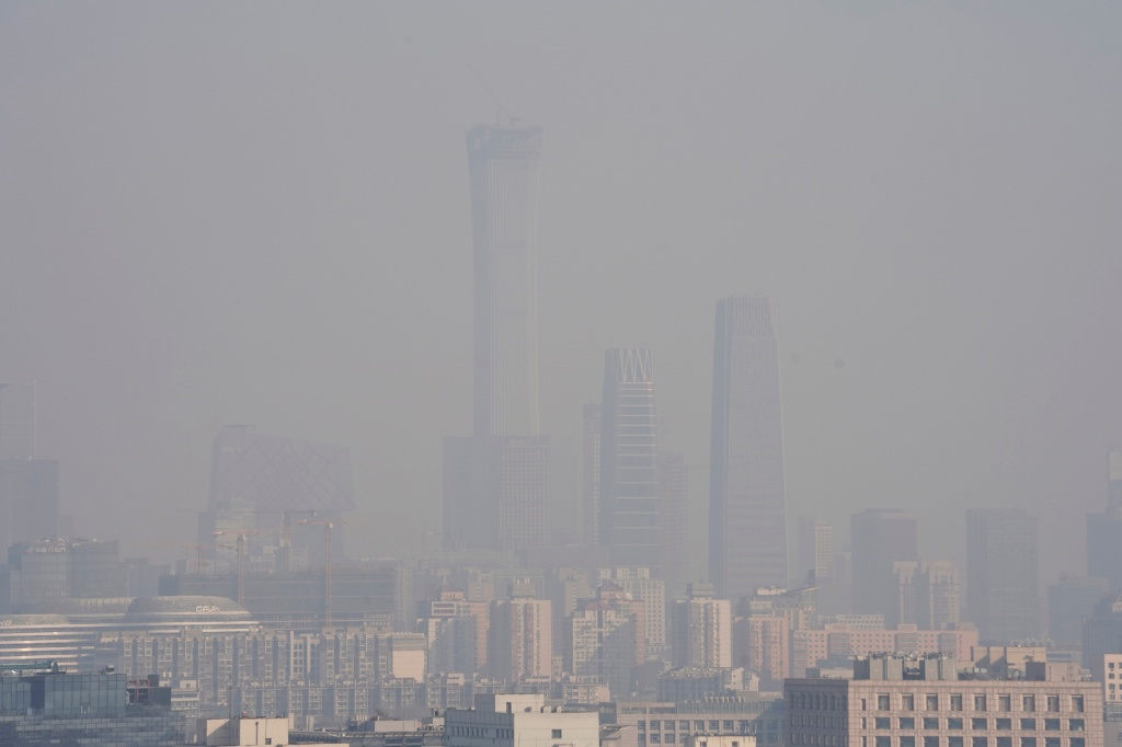 The City skyline is seen amid smog ahead of Chinese Lunar New Year in Beijing