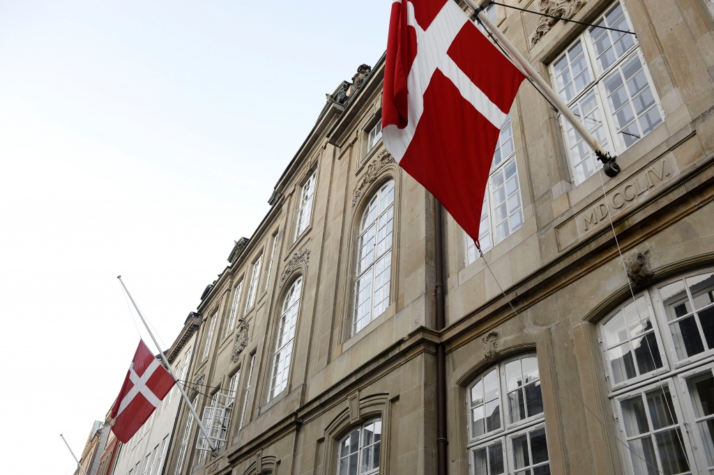 The flag on half staff is seen at Amalienborg Palace in Copenhagen