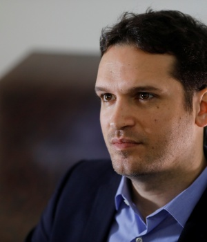 Perry, CEO of startup company D-ID, sits in his office during an interview, in Tel Aviv
