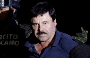 "Recaptured drug lord Joaquin ""El Chapo"" Guzman is escorted by soldiers at the hangar belonging to the office of the Attorney General in Mexico City"