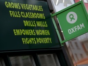 A sign is seen above a branch of Oxfam, in London
