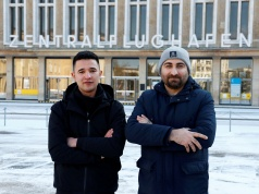 Ibrahim Al Hussein from Syria and and Qutaiba Nafea from Iraq pose for the photographer ahead of an interview with Reuters in Berlin