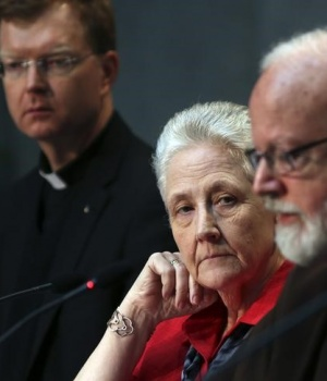 Collins, member of the Pontifical Commission for the Protection of Minors, watches as Cardinal O'Malley speaks during their briefing at the Holy See press office at the Vatican