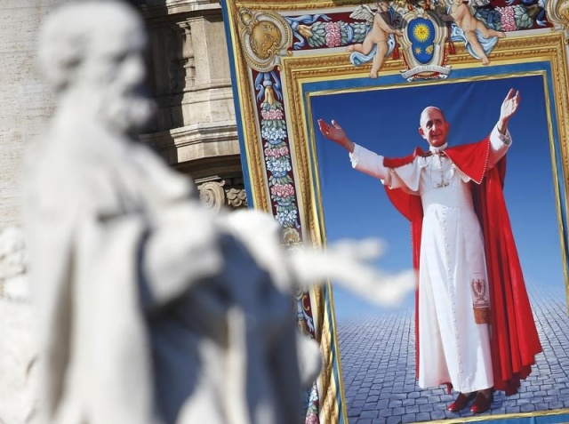 The tapestry with the image of Pope Paul VI is unveiled as Pope Francis celebrates the mass for his beatification in St. Peter's square at the Vatican