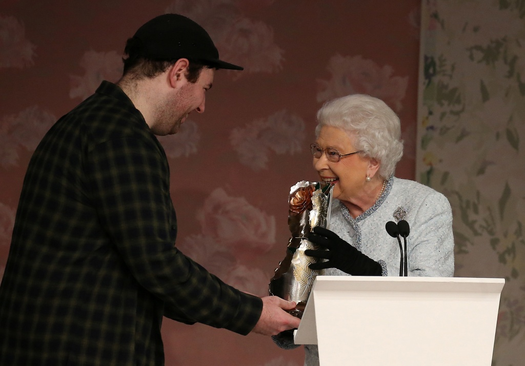 Britain's Queen Elizabeth II presents the inaugural Queen Elizabeth II Award for British Design to Richard Quinn after his show at London Fashion Week